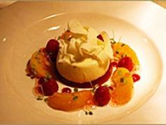 Vanilla pannacotta with raspberry jelly, poached peaches and white chocolate.