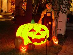 Pumpkins and a Scarecrow - Just a bit of the yard display. Cute is easier to pull off than scary during Halloween, unless you are really good at scary. Don't want to frighten off the Trick or Treaters, especially the little ones. On the porch is a la Check this out!