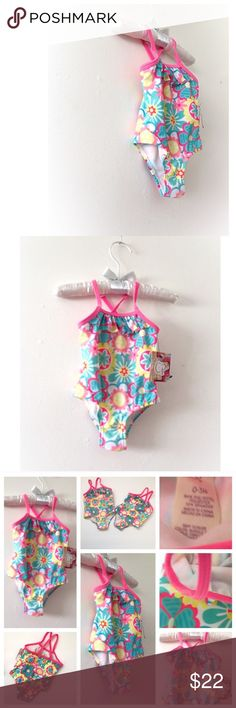 OP Newborn Baby Girl Floral One Piece Bathing Suit New OP Baby Floral / Hawaian One Piece Bathing Suit. Beautiful Bright Pink Blue/ Aqua Mint Green, Yellow & White Flowers Pattern, Front Ruffle, 50 PDF • criss cross back straps, super cute new born swimsuit • Baby's swimwear for first Spring / Summer or just because, pool party, vacation, beach • Great for baby shower gift, new mommy • Smoke  & Cat Free Home • God bless & Happy Poshing! Op Swim One Piece