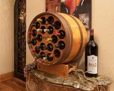 Barrel Wine Rack- great for storage and style. Even better if placed into a wall and there were three of them. With metal work between the barrels on the wall.