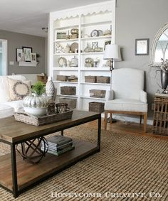 Paint Color: Silver Fox by Benjamin Moore in Eggshell Trim Color: Simply White by Benjamin Moore (semi-gloss) Couch: Ikea Ektorp Coffee Table: Home Decorators End Table: World Market White Wing Chair: TJ Maxx Linen Club Chairs: Joss and Main Console Table: Joss and Main (also available from Home Furniture Showroom and Wayfair) Rug: Overstock.com Arched Mirror: One King's Lane.