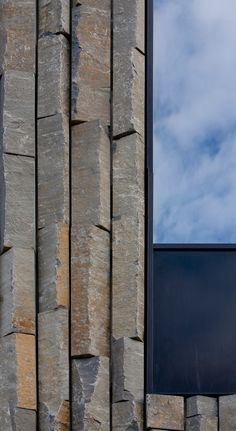 Robust local Icelandic granite cladding detail at the Akureyri Art Center in Iceland by Arkitema Architects