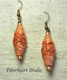 Carved carmel paper bead earrings by FiberheartStudio on Etsy, $14.00