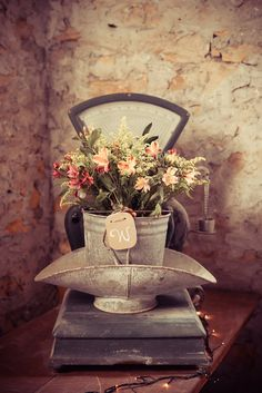 Vintage Farm bucket with  floral arrangement placed in a antique scale. ~ California Florals fresh from the farms of California! ~Stone Barn Farms~ Wedding/Event Venue