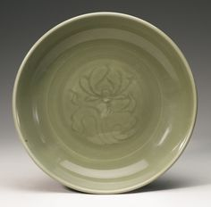 A 'Longquan' celadon carved dish, Ming Dynasty