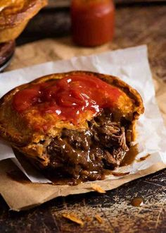 Close up of Meat Pie cut open to show meat pie filling inside, with tomato sauce on top Steak Pie Recipe, Recipe Tin, Meat Pie Pastry Recipe, British Meat Pie Recipe, Quiche Recipes, Meat Recipes, Cooking Recipes, Curry Recipes, Chicken Recipes