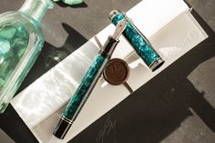 This special edition Pelikan Souverän M805 Ocean Swirl has a unique patterned material providing a truly spectacular look. The rings and clip are elegantly decorated with palladium, complemented by a rhodium-plated 18kt gold nib in extra-fine. The smooth operating piston mechanism allows you to fill this pen from bottled ink. <br><br>