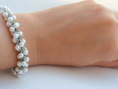 Hey, I found this really awesome Etsy listing at https://www.etsy.com/listing/176489893/white-pearl-beadwoven-bracelet-elegant