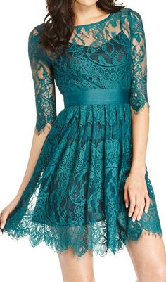 Teal lace dress. Would be badass with black stalkings and boots. Cause it needs more edge.