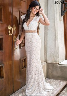 Breathtaking lace cap sleeve dress features an open back and sheer waistline