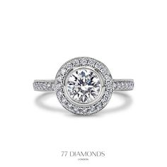 The Contessa ring is a modern take on a vintage ring with a bezel set halo of glittering round brilliant diamonds. Perfect for a vintage loving lady!