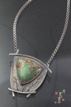 'The Haven' by Kathleen Krucoff.  Part of the Treescape series, this pendant combines a soft green Variscite stone set in Sterling Silver with the signature tree shapes in the setting.