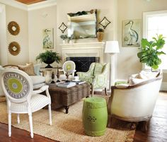 Neutral living room with pops of green and gold