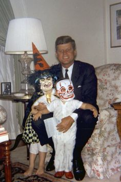 President Kennedy with his son and daughter Caroline and John on Halloween 1963.