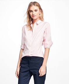 Our non-iron dress shirt is made from pinpoint oxford stretch cotton and is specially treated to remain virtually wrinkle-free. Darting at the front and back lends the silhouette a slim, tailored fit and appearance. This shirt features styling darts at the chest, a forward point collar and our signature 6-Pleat Shirring® at the single-button barrel cuffs. <br/><br/> Machine wash; imported.