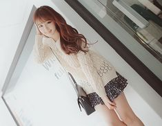 kim shin yeong in a very feminine, white crochet top