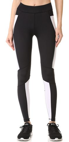 symmetry leggings by hpe. Paneled hpe leggings in smooth, two-tone jersey. Hidden elastic waistband. Fabric: Activewear jersey. Shell: 80% nylo...