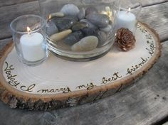 We used a wood burner to burn different quotes into the wood slice centerpieces.