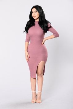 - Available in Mauve and Coco - Half Sleeve Dress - Mock Neckline - Below the Knee Length - Front Slit - Strappy Back Detail - Made in USA - 62% Polyester 34% Rayon 4% Spandex