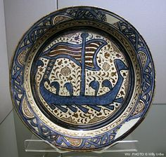 Earthenware flat basin (brasero), painted in cobalt blue and luster over a white glaze  Valencia, Spain, about 1400-1450