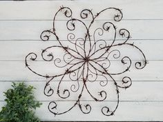 Wouldnt this barbed wire swirl add a bit of elegance to your rustic decor? Western Decor, Rustic Decor, Farmhouse Decor, Farmhouse Front, Rustic Cafe, Rustic Logo, Rustic Bench, Rustic Shelves, Rustic Theme