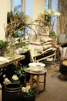 I like the rustic table and the all white flowers gives a warm feel to this display.