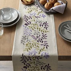Graceful leaves trail soft springtime colors, embroidered on natural linen-cotton. This stunning table runner is finished with a solid cotton backing and pairs beautifully with matching placemats. Hand Embroidery Videos, Hand Embroidery Patterns, Embroidery Art, Embroidery Stitches, Machine Embroidery, Border Embroidery, Vintage Embroidery, Crate And Barrel, Purple Table