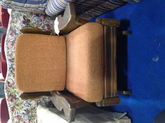 A chair at the ReStore right now, in great condition and perfect for lounging in any room!