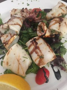 Grilled calamari at Coco Lezzone Restaurant on Avenue Road in Toronto Grilled Calamari, Caprese Salad, Toronto, Grilling, Restaurants, Menu, Food, Diners, Menu Board Design