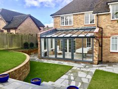 Bespoke grey aluminium lean to conservatory and landscaping project near Hemel Hempstead