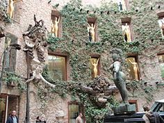 The Dalí Theatre and Museum, is a museum of the artist Salvador Dalí in his home town of Figueres, in Catalonia, Spain.  Courtyard view showing figurines.