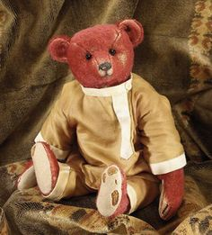 Alfonzo, red Steiff bear dressed in a Cossack uniform who belonged to Princess Xenia of Russia and who now lives with Ian Pout of Teddy Bears of Witney