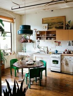Boho kitchen small roundtable green chairs