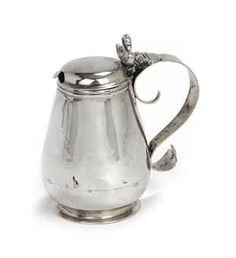 A Dutch silver mustard-pot  Mark of Arent Hamminck, Groningen, 1671/72  The pear-shaped mustard-pot on circular base, with shallow domed cover, the S-shaped handle with swan finial, marked on handle  9.9 cm. high  112 gr.