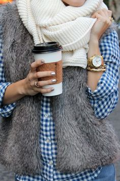 love the scarf, fur vest, accessories, & coffee... but lose the ugly blouse. Replace w/solid color blouse.