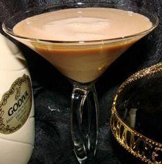 Pink Mocha Martini (1 ounce vanilla vodka   1 oz Chambord raspberry liquor   1 oz Kahlua   1 oz Godiva white chocolate liqueur   1 oz cold espresso)