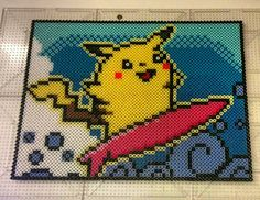 Surfing Pikachu perler beads by thevendelo