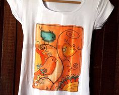 Paint by hand t shirt with birds. Unique hand painted t-shirt in orange, yellow, blue. Summer art t shirt. Birds shirt hand painted.