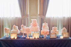 A table FULL of gorgeous wedding cakes- such a gorgeous statement! // photo by Lexia Frank Photography