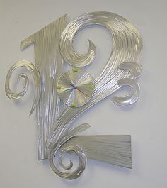 Big Time is a huge 3ft x 2ft abstract clock with a big 12, and a small 3,6&9.  very Contemporary brushed metal design - www.ViscardiDesigns.com $ 475 (ouch)