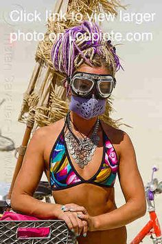 burning man - woman with motorcycle goggles and dust mask