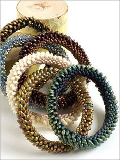 Adorn your wrist with this fantasy-inspired bracelet design that that looks like dragon scales. Combine ladder, brick, and peyote stitches to make these strikingly cool bracelets. Fascinating to behold, these unique bangles are exceptional and give the
