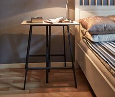 A night table in Mia's bedroom, with the extra legs for the spare table top used as night table legs.