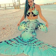 Mermaid Raven of Merbella studios in her custom turquoise silicone mermaid tail