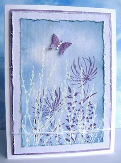 Layering  Distress inks (broken china, faded jeans, dusty concord & antique linen), white embossing powder, watercolour paper, Crackle Accents, gems and twine.