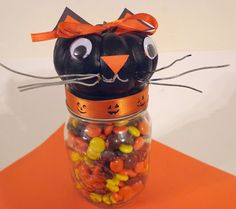 Cute Halloween Cat made with a mini pumpkin. Easy enough for kids!