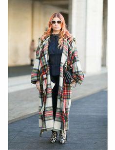 Becca Alexander wears a JC de Castelbajac coat, Elie Tahari top and jeans, Chanel bag, Marc Jacobs shoes and Chloe sunglasses.