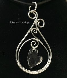 #301 - Swarovski Crystal asymmetrical heart pendant wire wrapped in solid sterling silver