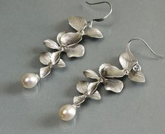 ".:* L - Matte finished white gold plated orchid flowers with wire wrapped freshwater white pearl.Earrings are 2-1/4"" (55mm) in length including the silver plated ear wire. By balance9 on etsy"