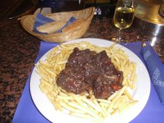 Oxtails braised in red wine served over crispy chips and a super dry sherry......Granada, Spain 2011